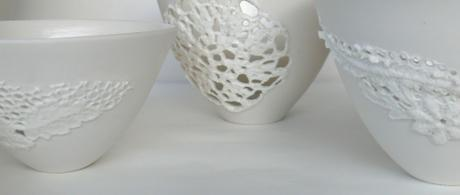 1.5  White porcelain bowlls with lace cut outs.
