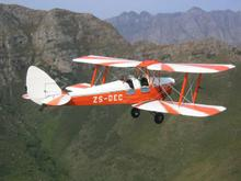 Pat flies her Tiger Moth