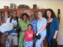The crew with Mamela's sister and her family