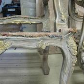 distressed chair with old gilding detail