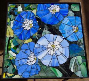Morning Glory glass mosaic on wrought iron table.    SOLD for R3000