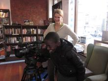 Pamphilia's 12 year old son Mokgethwa gets a lesson in camerawork from Karen Landsberg
