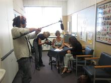 The crew films Andrea's speech therapy lesson