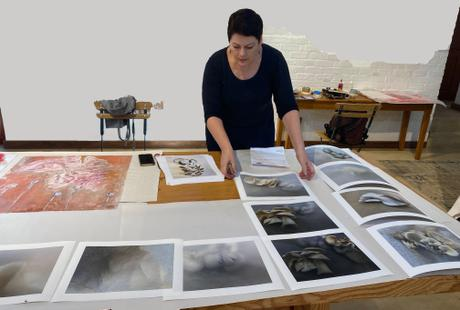 Gwen Miller in the studio, sorting through the works produced during her residency.