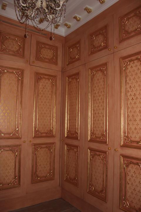 Enigma Mansion: subtly aged doors with gold stenciling and aged gilded beading detail