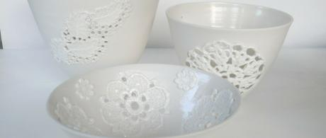1.3 White porcelain bowls with lace cut outs.