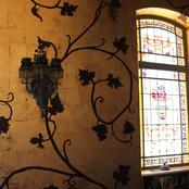 Enigma Mansion: antiqued gold leafed walls with hand painted vines