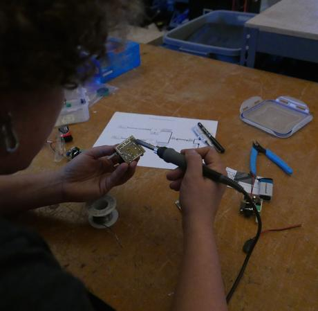Sasha soldering the circuit board.