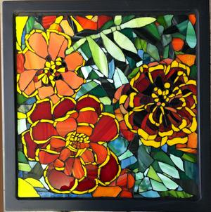 Glass mosaic of 3 marigolds on wrought iron table. NOT FOR SALE