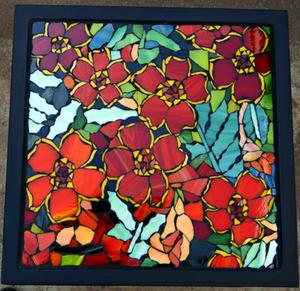 Glass mosaic marigold pattern on wrought iron table. NOT FOR SALE