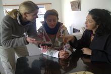 The team confers: Karen Landsberg (camerawoman), Anna Telford (director) & Lisa Chait(show host)