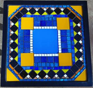 Geometric pattern glass mosaic on small square wrought iron table. R2000