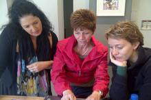 Jill shows Lisa and Anna her resurrection plant videos