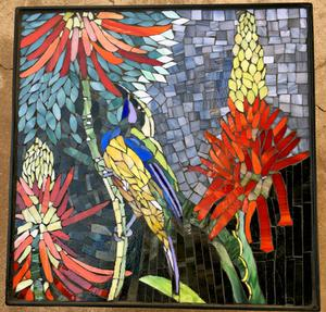Aloe & Sunbird glass mosaic on large square wrought iron table.    SOLD for R3000