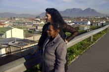 Sindiwe & Lisa on the  bridge where Sindiwe stood aged just 23, at the lowest point of her life