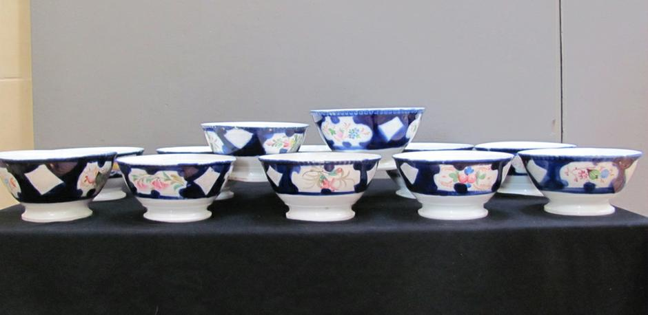 set of two dozen Russian Kushnitsov bowls  with  Cyrilic / Farsi marks • circa 1900