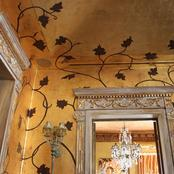 Enigma Mansion:antiqued gold leafed walls with hand painted vines