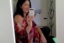 Lisa filming her video blog