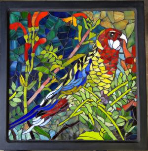 Glass mosaic parrot on wrought iron table. SOLD for R2000