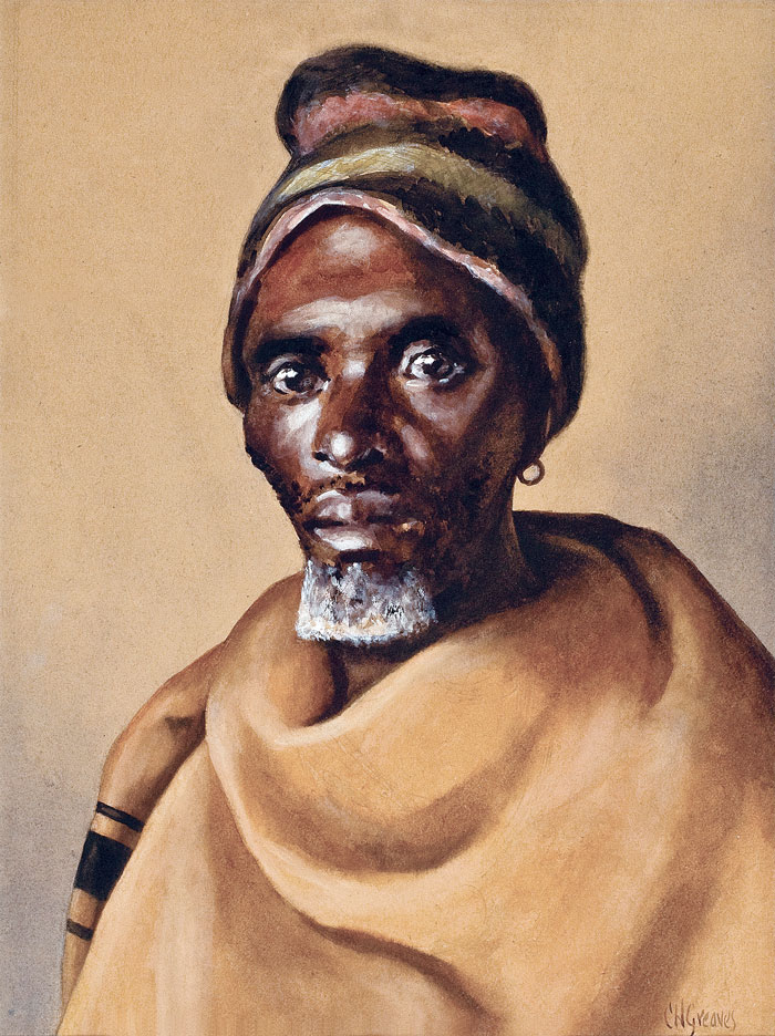 Portrait of a man in a cap and a blanket