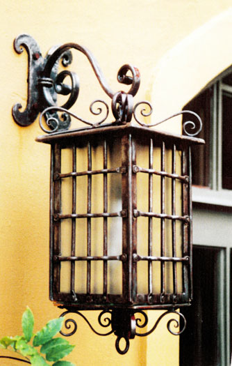 Forged and riveted coach lantern with decorative wall bracket and frosted glass panes (DETAIL)