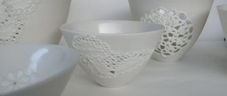 1.4 White porcelain bowls with lace cut outs.