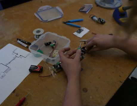 Sasha assembling the electronic components.