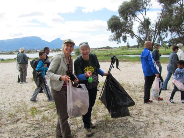 Michele Ross-Innes, Mariette Daubenton, and others clean up the Vlei after the prayer meeting