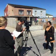 The crew films Janine performing one of her spoken word poems on the streets of Mitchells Plain