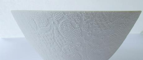 1.2 White porcelain bowl with lace slip texture.