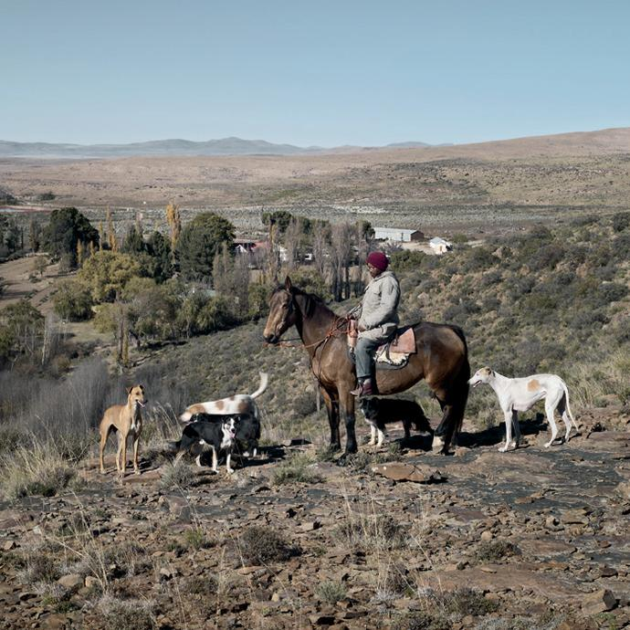 Ralles with his pack of hunting dogs. Waterkrans farm, Richmond, Northern Cape, 12 May 2010