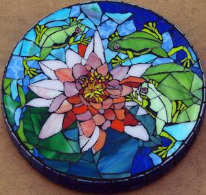 Glass mosaic waterlily on concrete stepping stone. SOLD R900