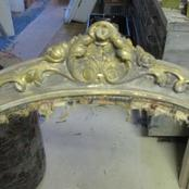 distressed chair with aged gilding