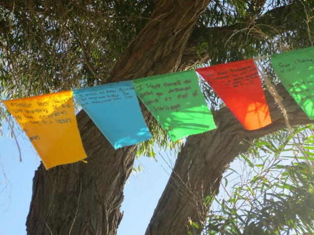 Prayer flags made by children from local schools