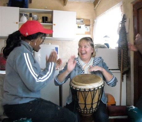 Ella shares her drumming skills with Louise