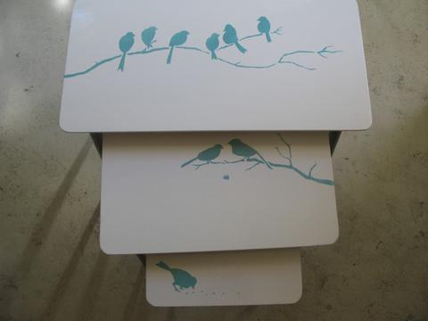 bird motifs painted on stack tables