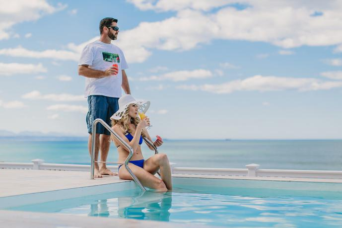 thumbnail for Advertising shoot with models at a pool with drinks for a guesthouse in Mossel Bay, Garden Route.