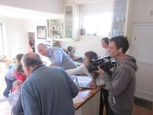 Tim films the Karabus family at home.