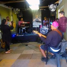 Blaq Pearl and her band rehearse in a garage music space