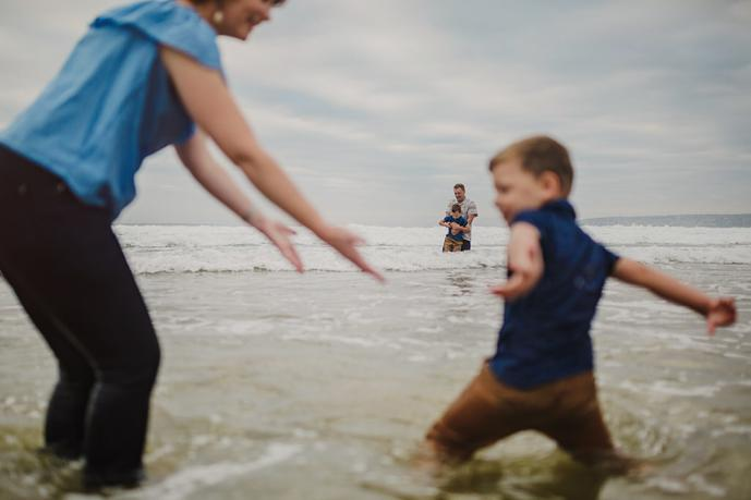 thumbnail for Beach family photoshoot in the water at Hartenbos in South Africa.
