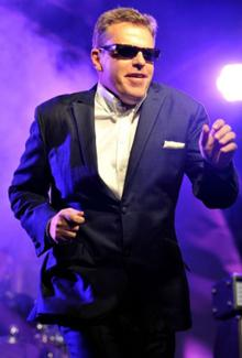 Suggs from Madness performing in Regent Street