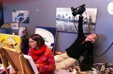 Camerawoman Karen Landsberg reaches for the shot as Heather has her weekly art session