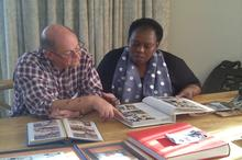 Nozizwe and husband Jeremy page through the family albums