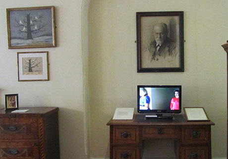 Sissi beneath Freud, next to the Wolf Man paintings
