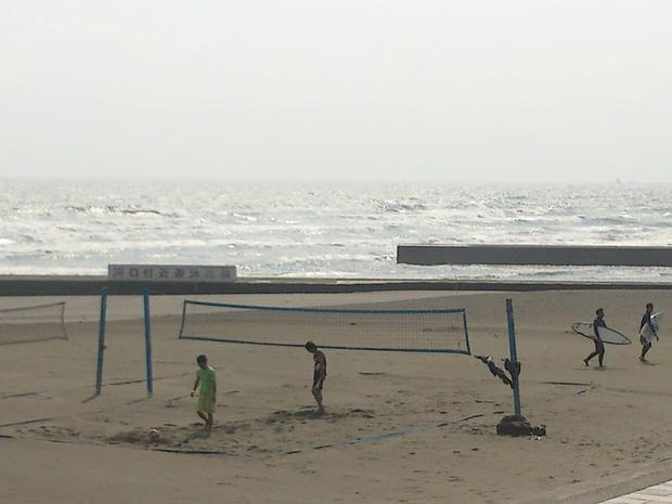 Volley ball and surfers