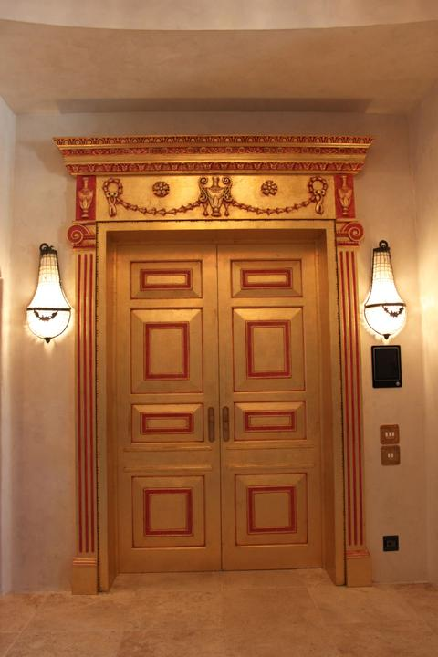 Enigma Mansion: gold leafed doors with red detailing