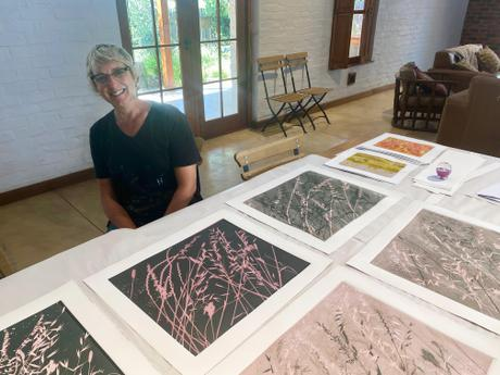 Jenny Parsons with some of the monotypes that she produced during her residency.