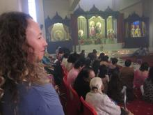 Director Izette Mostert has a quiet moment at the Hindu temple during filming