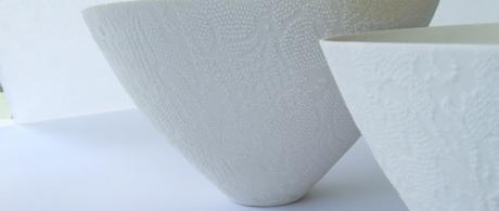 1.10  White porcelain bowls with lace slip texture.