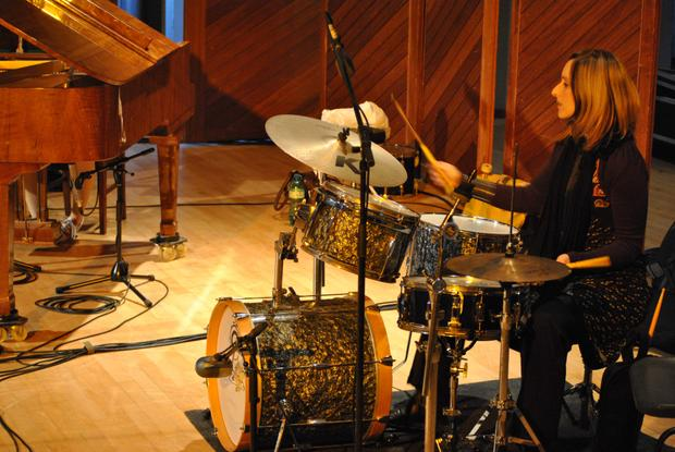 Lisa Bauer on drum set live at the Nassau Centre, Claremont.